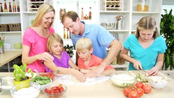 Family preparing together homemade pizza — Stock Video © Spotmatik ...