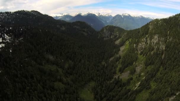 Aerial view snow capped Peaks mountain valley wilderness, Canada