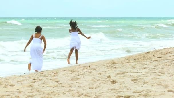 Women playing on the sea beach