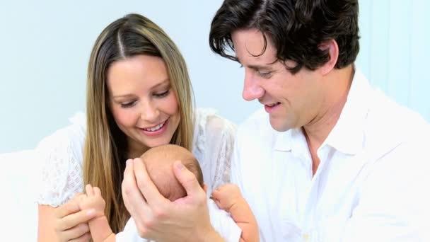 Newborn baby boy in the hands of parents