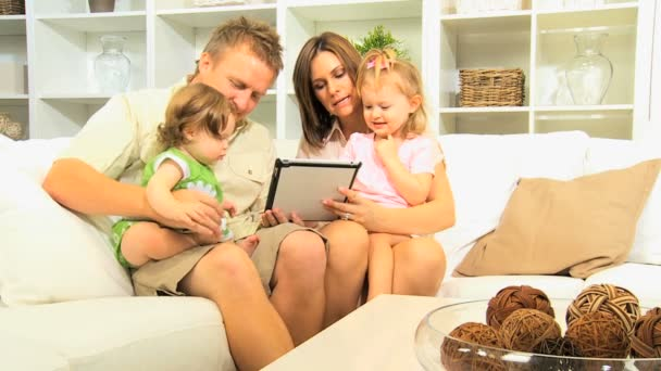 Family playing games on tablet at home