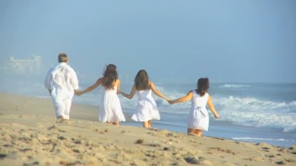 Parents Teenage Daughters Walking Linked Hands Beach