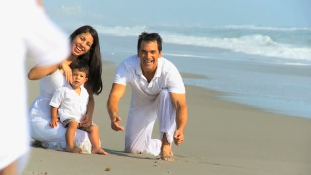 Young Hispanic Family Playing Sand Beach