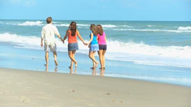 Caucasian Parents Teenage Girls Walking Together Beach