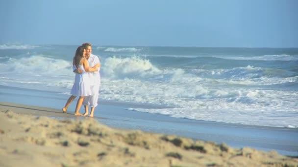 Attractive Couple Enjoying Time Walking Beach
