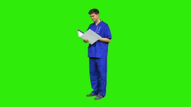 Male nurse consulting patient records