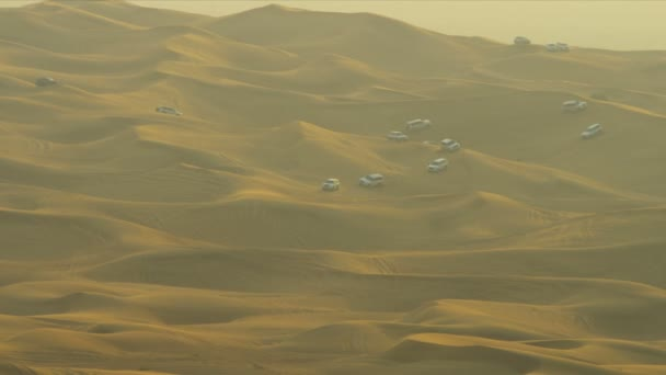 Professional tourism companies driving people in off road vehicles across sand dunes
