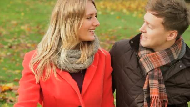 Caucasian couple in Autumn share kiss