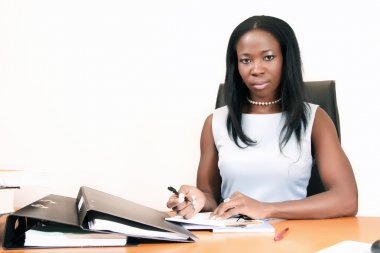 Young African American Business woman writing Reports
