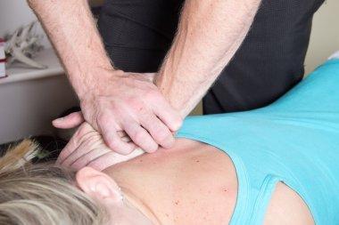 Chiropractor treating patient shoulder pressure