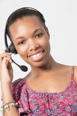 Young african american call center agent laughing.