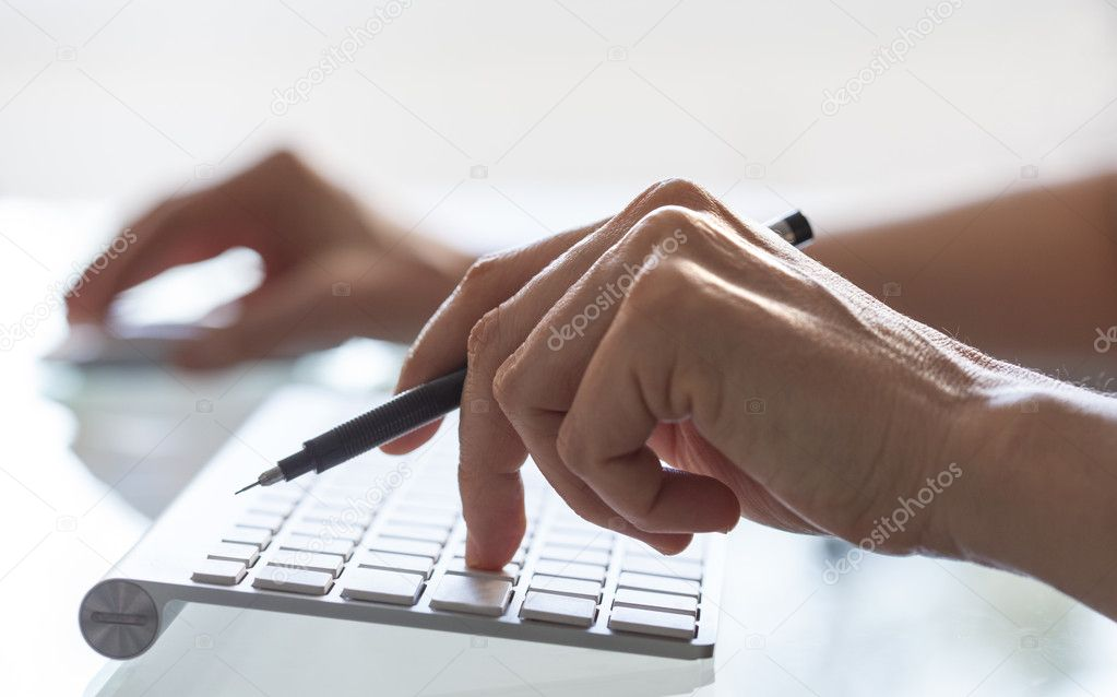 Close-up of woman hands on computer keyboard