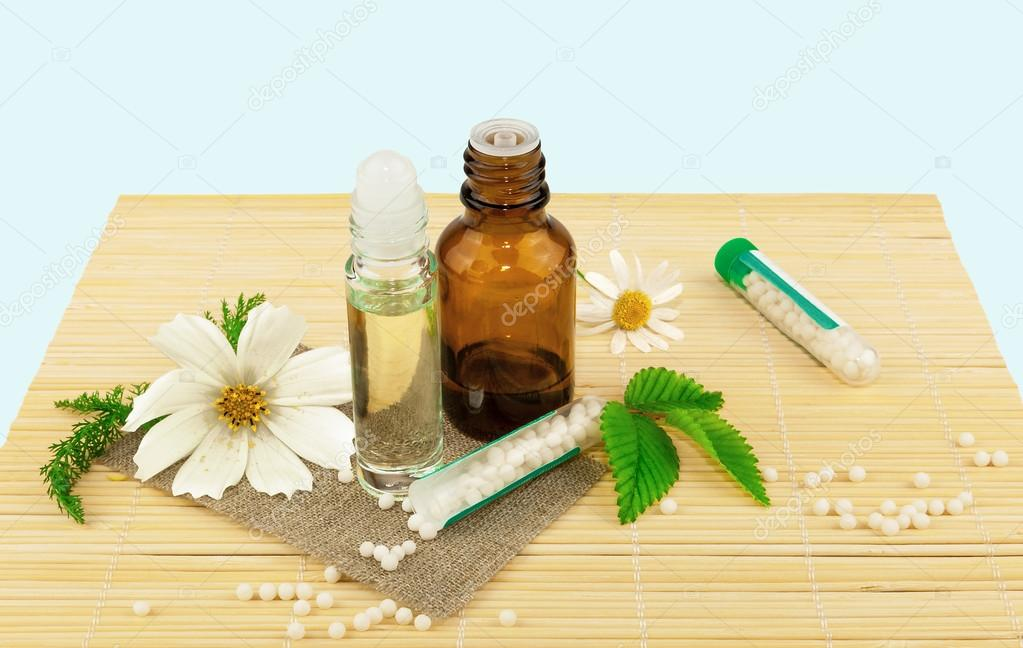 Homeopathic medication with flowers and leaves