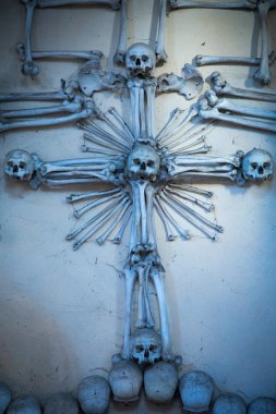Ancient holy rood made from human skulls and bones in Sedlec Ossuary, Kostnice cemetery church of All Saints in Sedlec