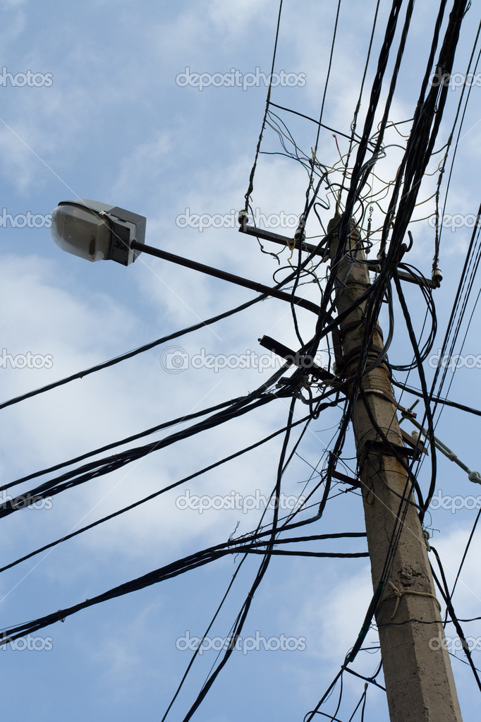 Lamp pole and tangled electric wires — Stock Photo © SergeyAK #15341173