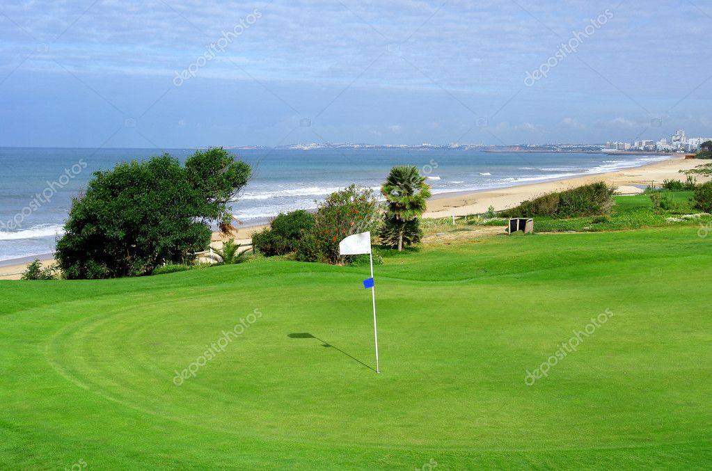 Beach and golf coastal scenario