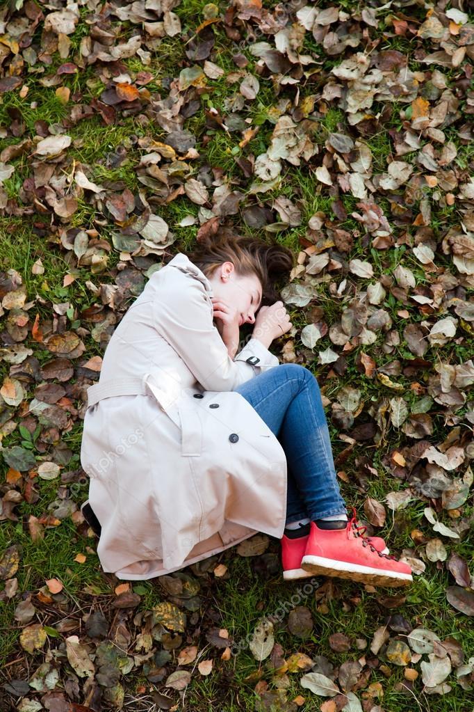 girl lying on the ground