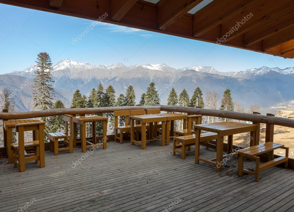 cafe with a view of the mountains against the blue sky