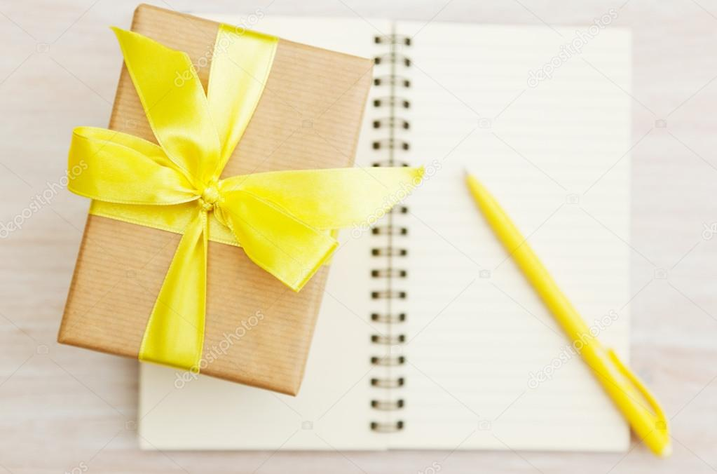 Box with a gift and a notebook