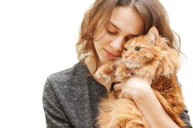 beautiful young woman 20 years with a fluffy red cat isolated