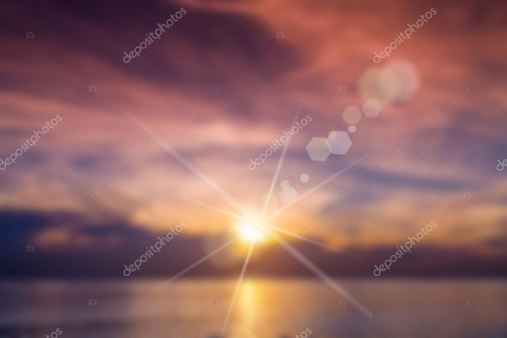 bright colorful sunset over the sea, in soft focus