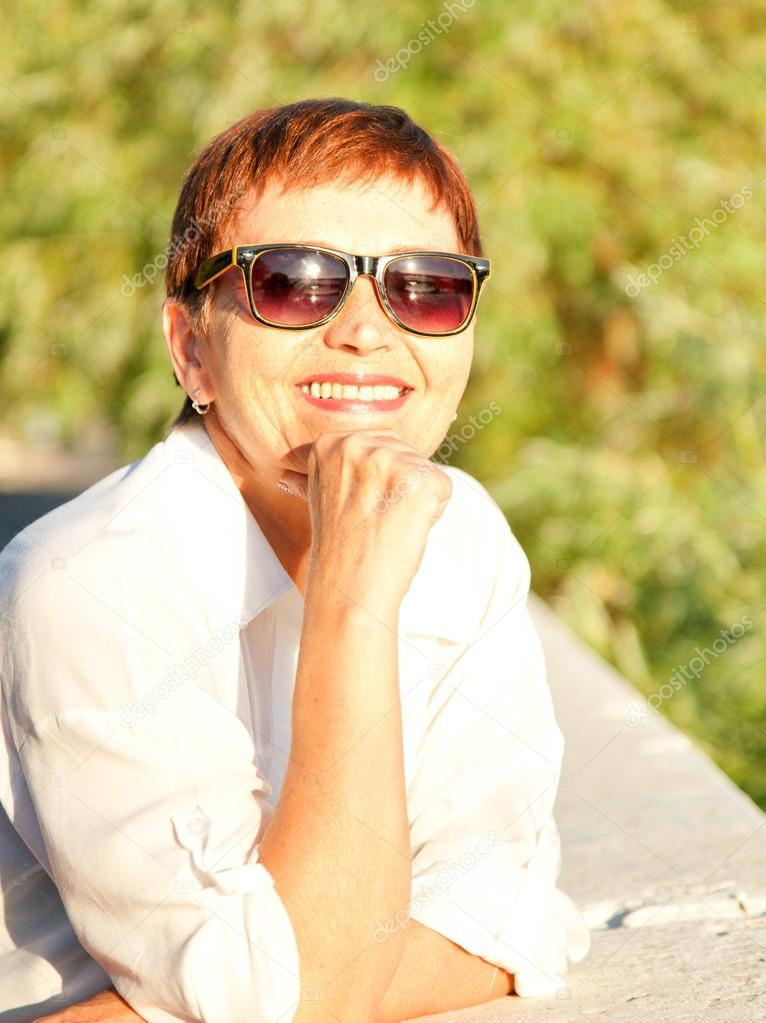 beautiful woman 50 years in sunglasses, Outdoors