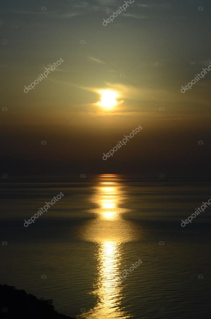 Sunrise over the sea with a long and wide sunny lane