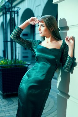beautiful young woman posing on the street showing dresses