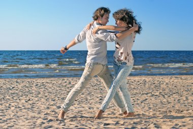 Couple dancing by the sea