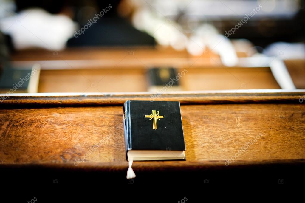 Still photo of bible put on wooden desk in church stock vector