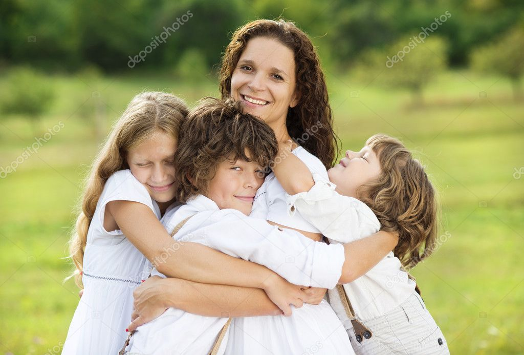 Children and mother hugging