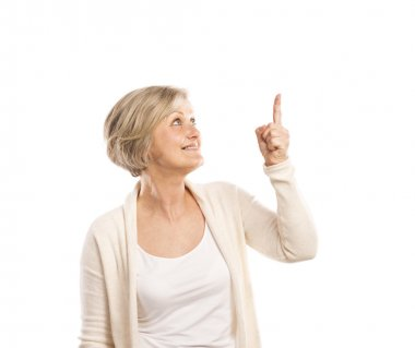 Senior woman pointing up on white background stock vector