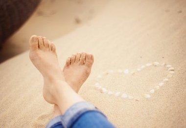 Closeup of female feet at the beach