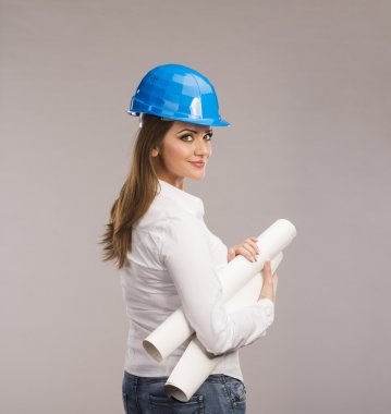 Portrait of Young woman architect with blue hard hat and paper plans, isolated on white background stock vector