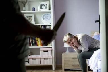 Woman scared of man with knife