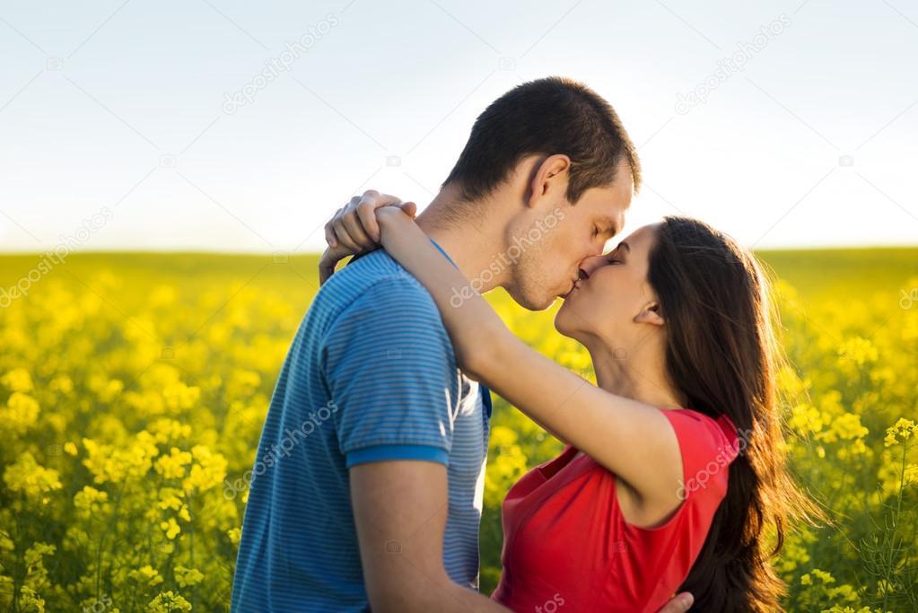 Couple kissing in field