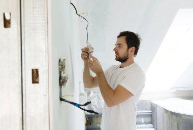 Electrician installing light