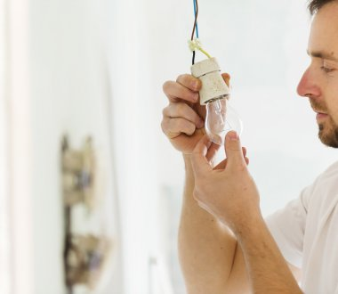 Electrician installing light