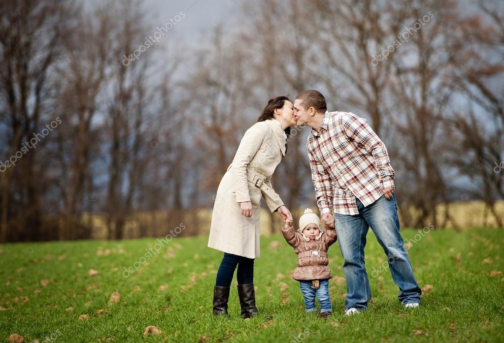 Happy family in autum nature
