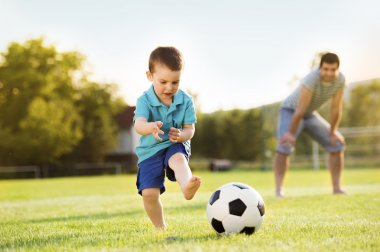 Father with son playing football