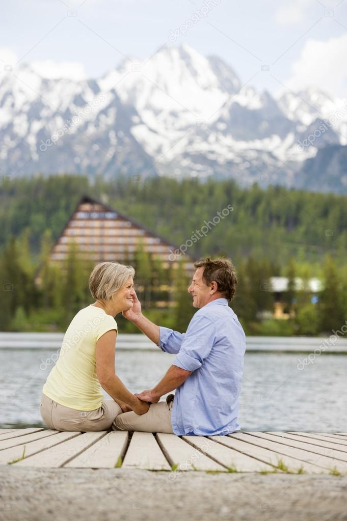 Senior couple sitting on pier