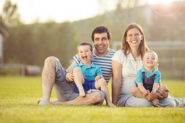 Happy family on football pitch