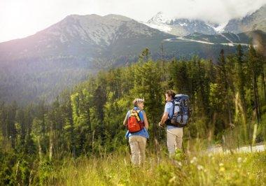 Tourist couple at mountains