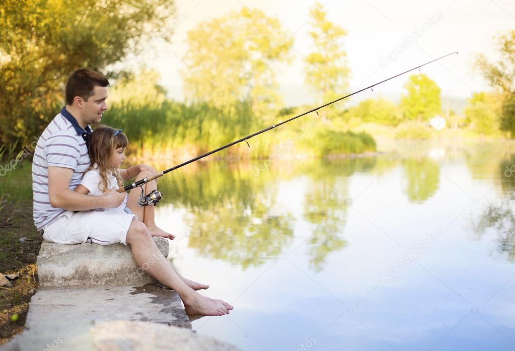 Father fishing with his daughter
