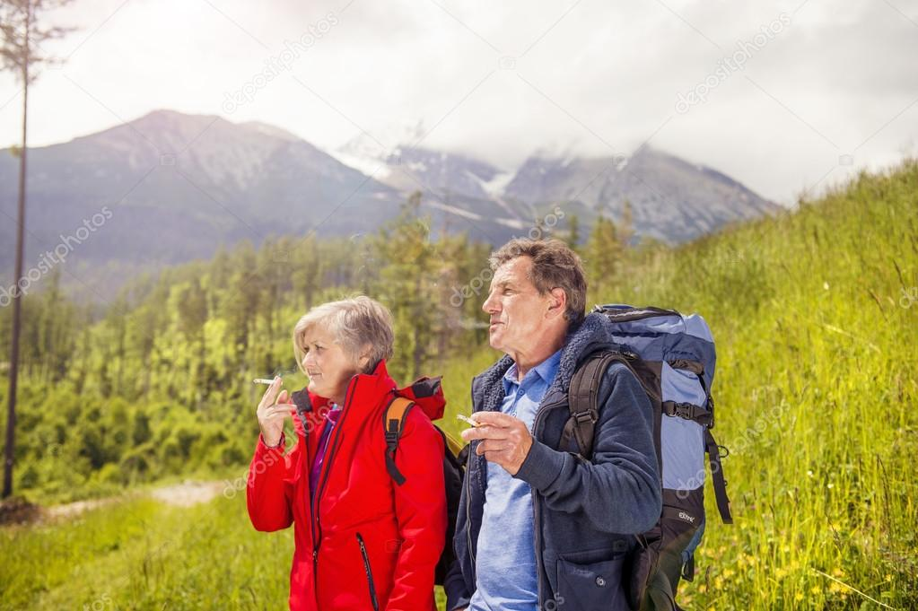 Tourist couple hiking at mountains