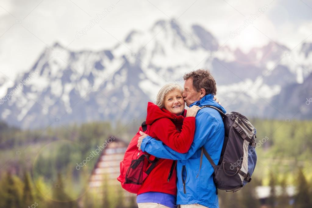 Couple hugging at mountains