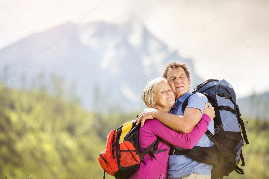 Couple hiking at mountains