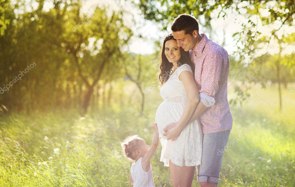 Pregnant family having fun