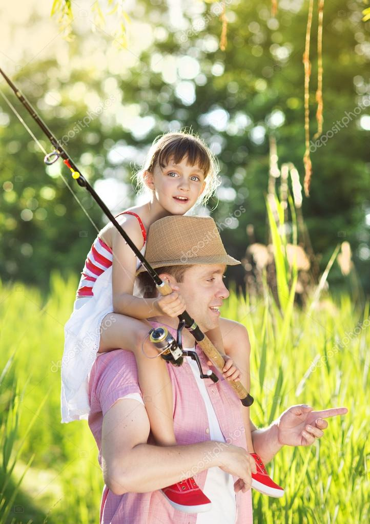 Father with daughter going fishing