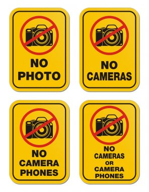 No cameras or camera phones signs